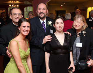 Dominic Missimi (back) is surrounded by family members, including (from left to right) his brother, Monsignor Anthony Missimi, daughters Emmi and Angela and his wife Nancy Missimi, a prominent Chicago-area costume designer.