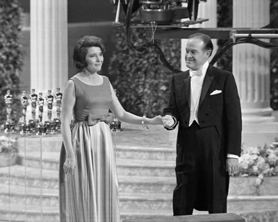 Bob Hope welcomes actress Patricia Neal