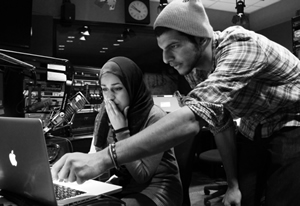 """Rayyan Najeeb and Maryam Jameel-Kakwan (J13) work on a WNUR radio program called """"Hip Hop and Hummus"""" together. Najeeb, """"probably the only RTVF, psychology, premed student ever known to man,"""" is active in intramural sports, Inspire Media, and the Muslim Cultural Student Assocation on campus. Photo by Kawther Albader (J13)"""