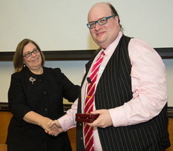 Dean Barbara O'Keefe and Jonathan Sterne shaking hands